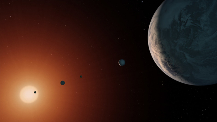 This illustration shows what the TRAPPIST-1 system might look like from a vantage point near planet TRAPPIST-1f (at right). Credit: NASA/JPL-Caltech